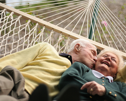Elderly couple swinging on hammock